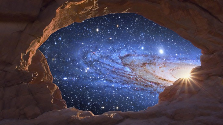 "A galaxy seems to rise like a sun through a natural sandstone arch in this digital composite. The galaxy is M31, the Great Galaxy in Andromeda. The image of the Andromeda Galaxy was taken using a Cassegrain 14.5"" at f/8. --- Image by © Tony Hallas/Science Faction/Corbis"